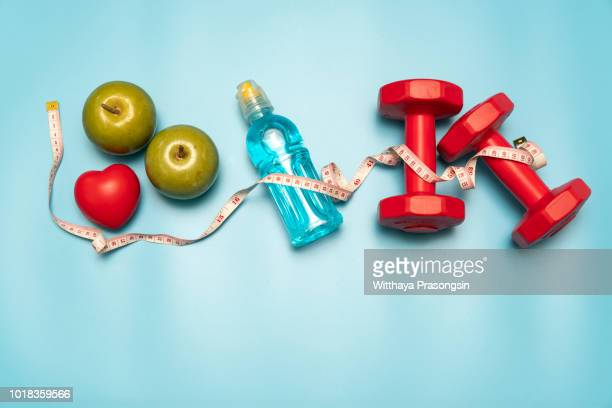 fitness equipment. healthy food. water,apple - weight loss stock pictures, royalty-free photos & images