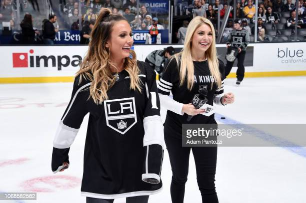 Fitness expert Paige Hathaway and in-arena host Kayla Knierim smile while Hathaway films a short video with during the second intermission of the...