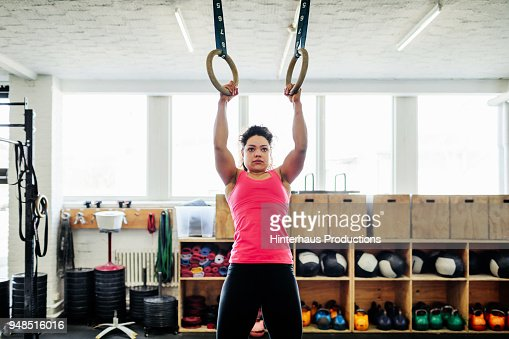Fitness Expert Using Gymnastics Exquipment