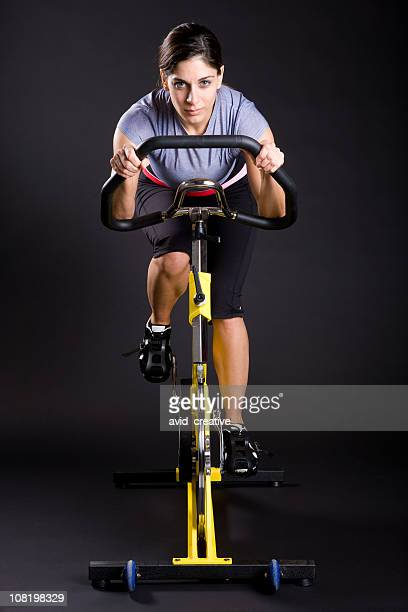 fitness girl exercising on spin cycle - peloton stock pictures, royalty-free photos & images