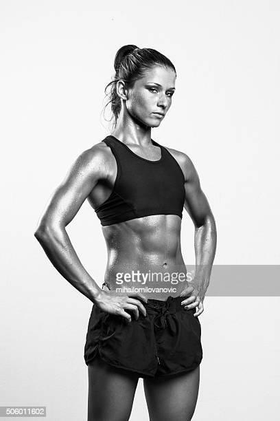 Fitness girl posing in studio
