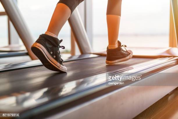 fitness girl running on treadmill - exercise equipment stock pictures, royalty-free photos & images