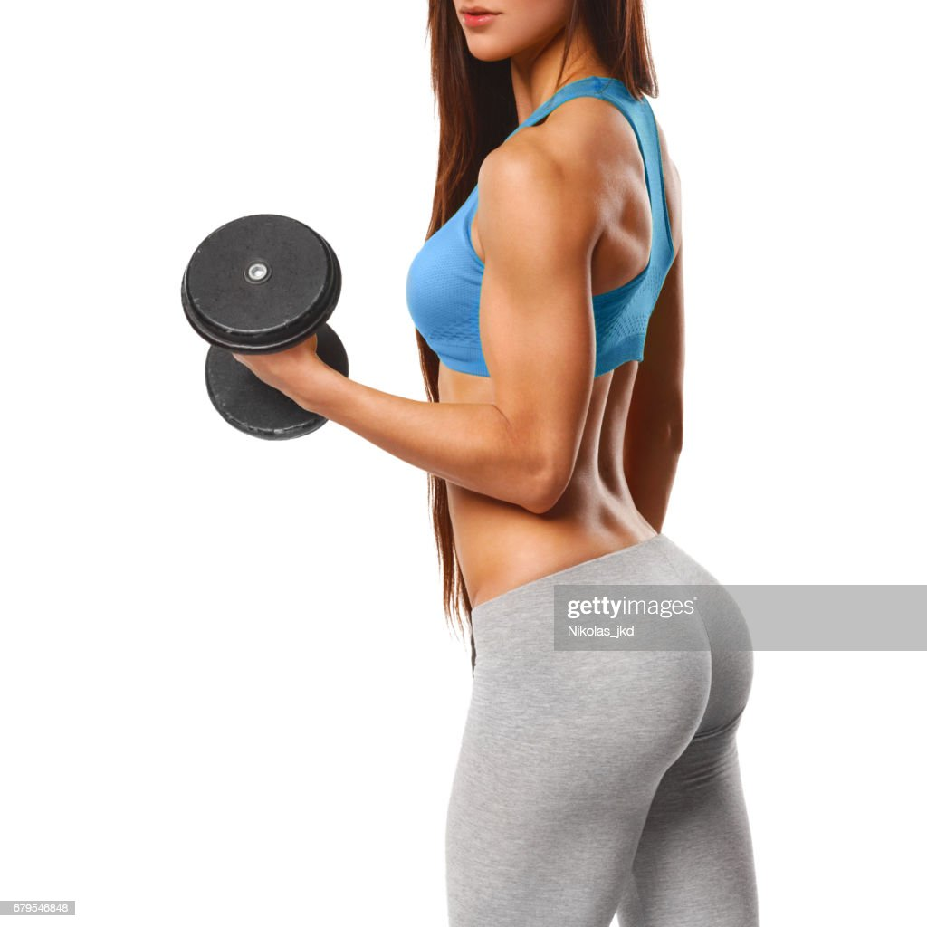 0680c120b1ab Fitness girl, sexy athletic woman working out with dumbbells. Beautiful ass  in thong.
