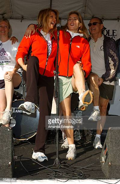 Fitness guru Kathy Smith and actress Tea Leoni stretch in a warmup session at the 8th Annual Expedition Inspiration TakeAHike at Paramount Ranch in...