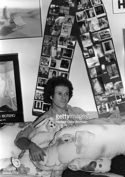 Fitness guru Richard Simmons poses for a portrait session with stuffed animal pigs at home in August 1980 in Los Angeles California