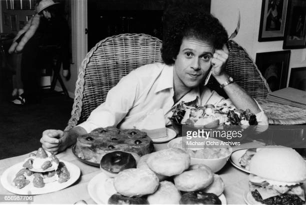 Fitness guru Richard Simmons poses for a portrait session with table full of food while playing himself on the TV show 'General Hospital' in August...