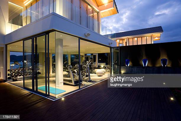 fitness gym health club luxury villa house - patio doors stock pictures, royalty-free photos & images
