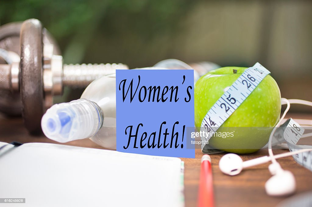 Fitness, health themed scene with Women's Health note. : Stock-Foto