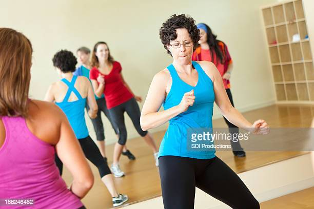 Fitness instructor dancing while leading class
