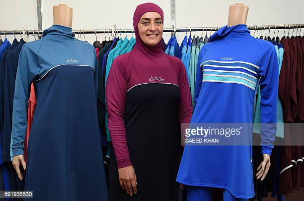Fitness instructor Fatma Taha wears a burkini swimsuit as she poses for pictures at a shop in western Sydney on August 19 2016 Part bikini part...