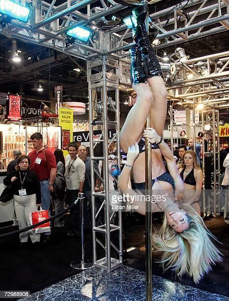 Fitness instructor Katie Coates performs on an XPole at the Adult Video News Adult Entertainment Expo at the Sands Expo Center January 12 2007 in Las...