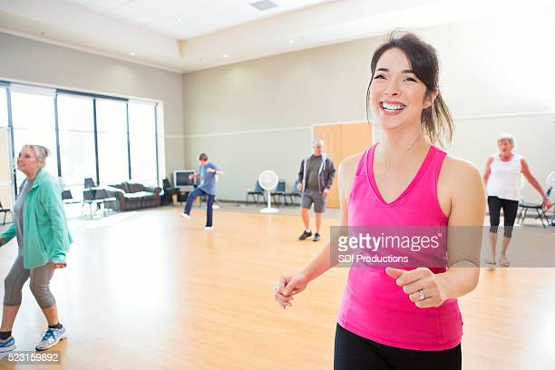 Fitness instructor leads dance class