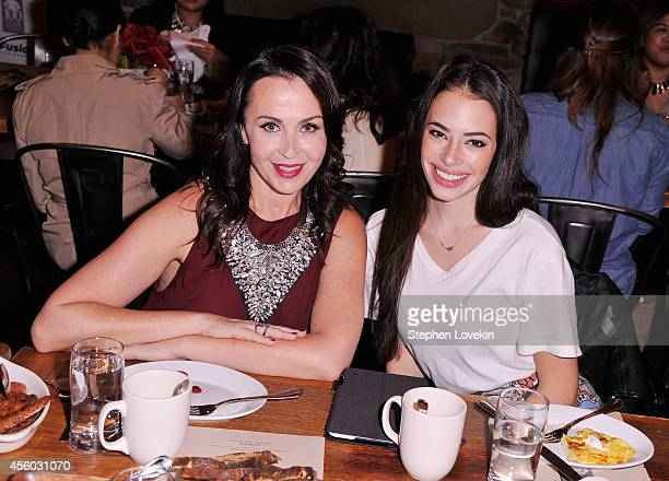 Fitness instructor Nicole Stuart and actress Chloe Bridges attend the Tracy Paul Company Productions Jack LaLanne 100Year Anniversary event on...