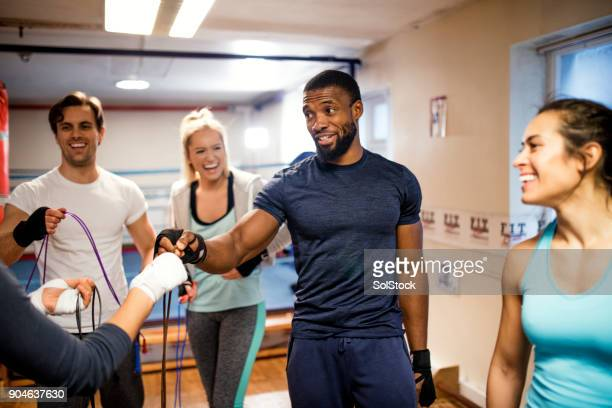 fitness instructor taking a class - mixed boxing stock photos and pictures