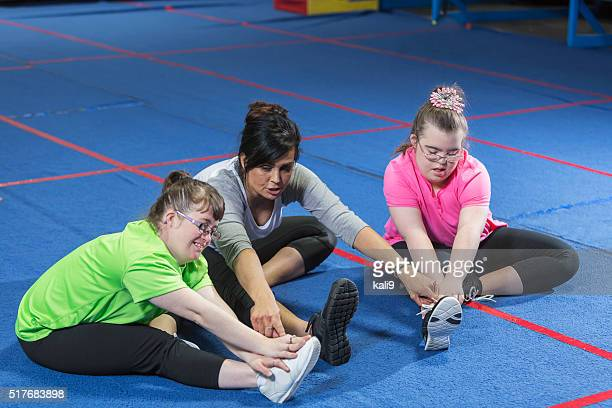 Fitness instructor working with special needs girls