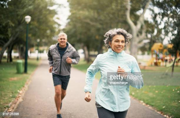 fitness is an important part of their marriage - active senior woman stock photos and pictures