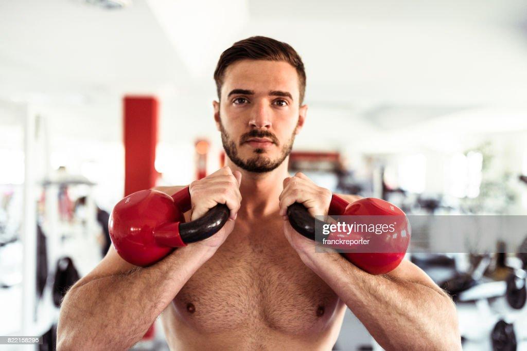 fitness man doing the ketllebell swing : Stock Photo