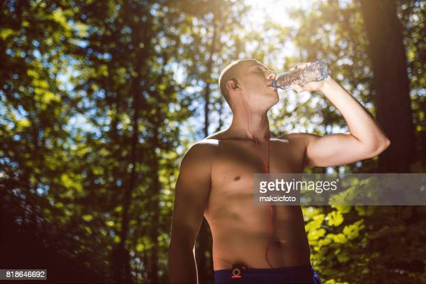 Fitness man drink water
