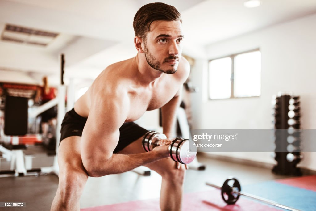fitness man showing the bicep : Stock Photo