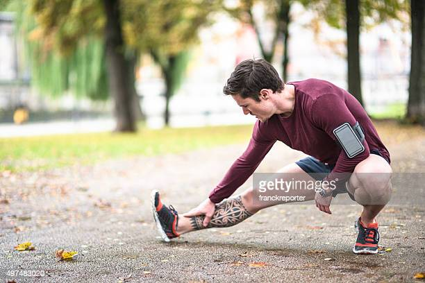 Fitness man stretching the calf in berlin after run