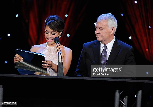 Fitness model Andrea Calle and UFC co-founder Campbell McLaren present the Journalist of the Year award during the sixth annual Fighters Only World...