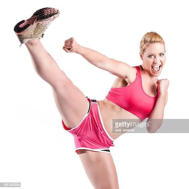 Fitness Model Doing High Kick