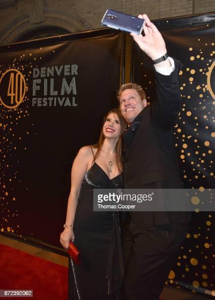 Fitness model Jasmin Gube and actor Hawk Younkins arrive at the 40th annual Denver Film Festival on November 9 2017 in Denver Colorado