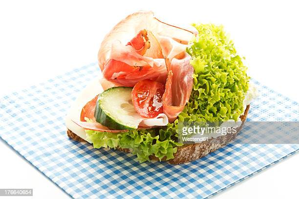 Fitness sandwich with cream cheese, ham, tomatoes and cucumber, close up