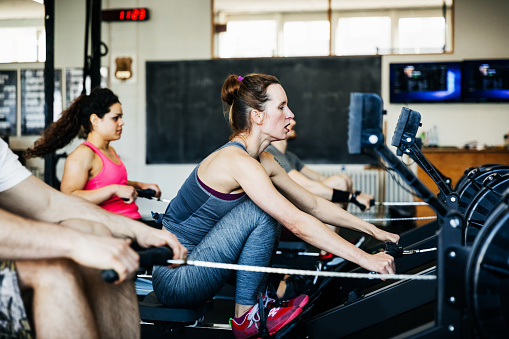 Fitness Team Using Rowing Machines Together - gettyimageskorea