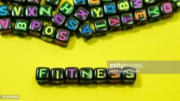 Fitness Text With Colorful Alphabet Blocks On Yellow Background