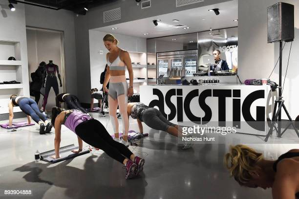 Fitness trainer and founder of The Rope Amanda Kloots holds a workout class at the new ASICS Flagship store on December 16 2017 in New York City
