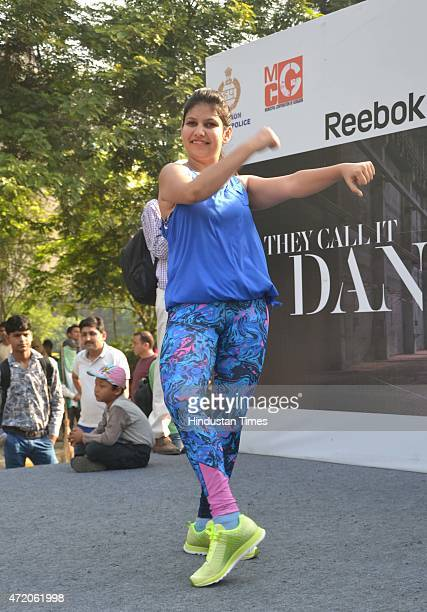 Fitness trainer Aparna and his partner perform the Zumba fitness dance on the Raahgiri Day organised by the Gurgaon administration along with support...