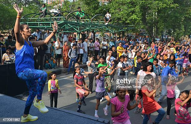 Fitness trainer Aparna performs the Zumba fitness dance on the Raahgiri Day organised by the Gurgaon administration along with support from EMBARQ...