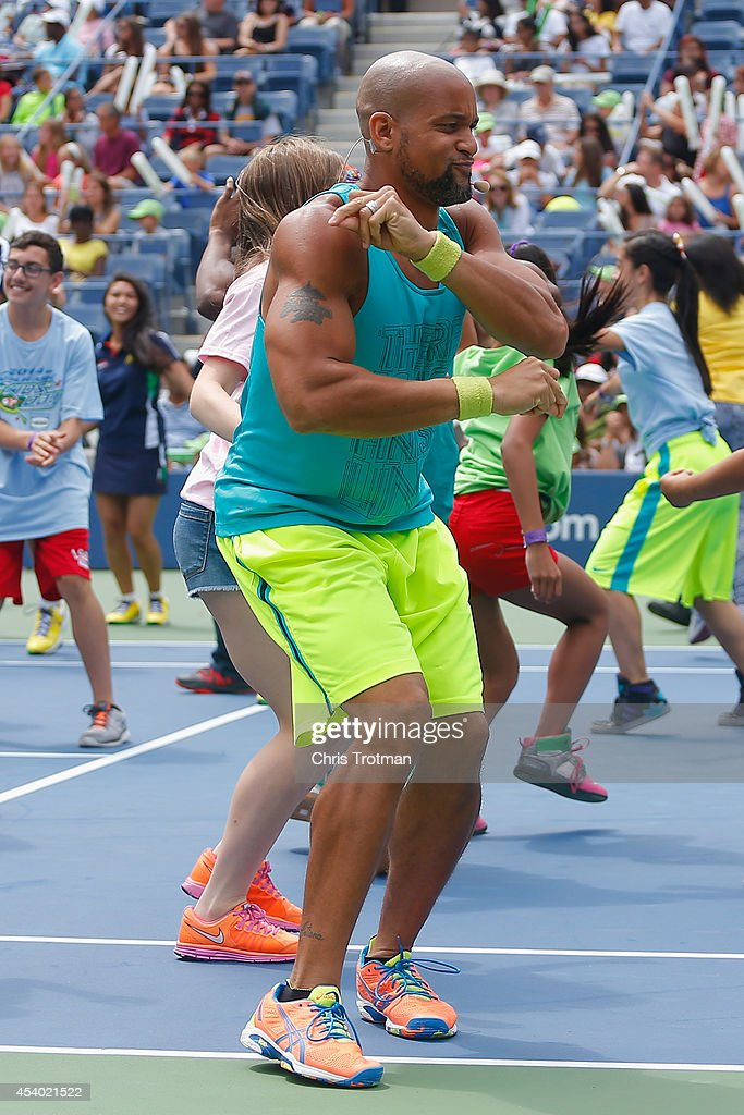 Fitness trainer Shaun T dances during Arthur Ashe Kids' Day prior to the start of the 2014 U.S. Open at the USTA Billie Jean King National Tennis Center on August 23, 2014 in the Flushing neighborhood of Queens in New York City.