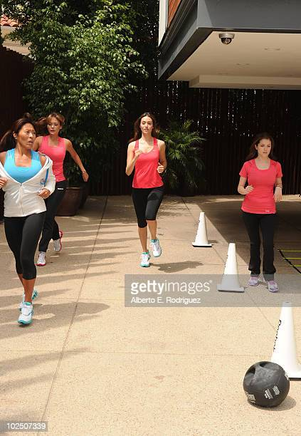 Fitness trainer Yumi Lee actresses Lindsay Price Emmy Rossum and Anna Kendrick attend the Reebok Women's Fitness event on June 16 2010 in Los Angeles...