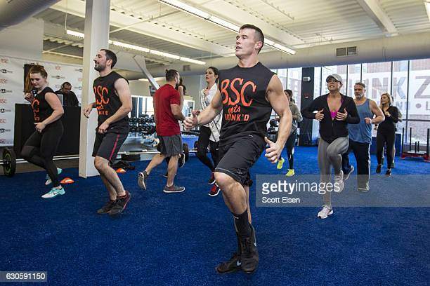 Fitness trainers at Boston Sports Club lead the first Gronk Zone workout on December 27 2016 in Medford Massachusetts