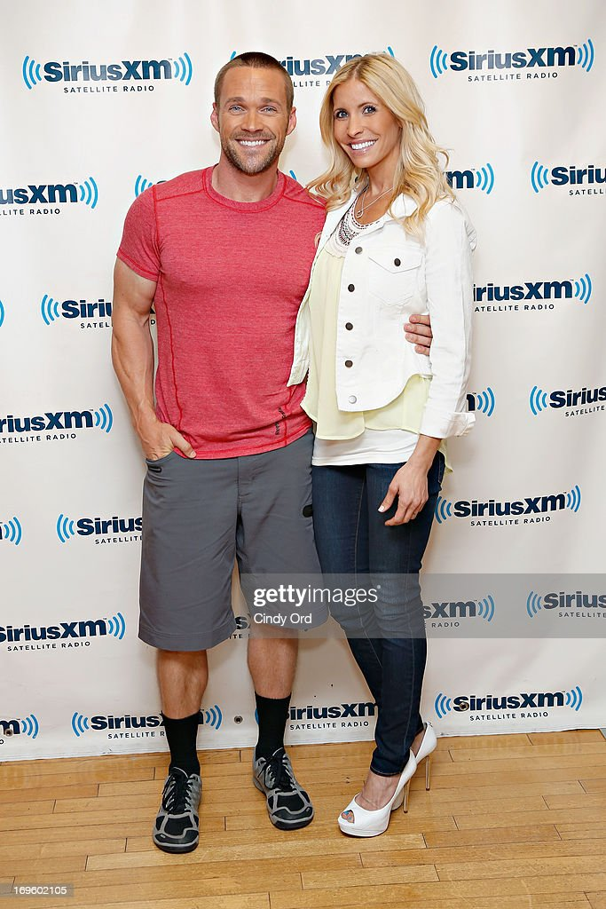 Fitness trainers/ TV personalities Chris Powell and his wife Heidi Powell visit the SiriusXM Studios on May 28, 2013 in New York City.