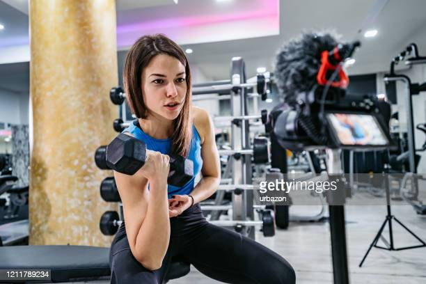 fitness vlogger making a video of herself at the gym - live streaming stock pictures, royalty-free photos & images