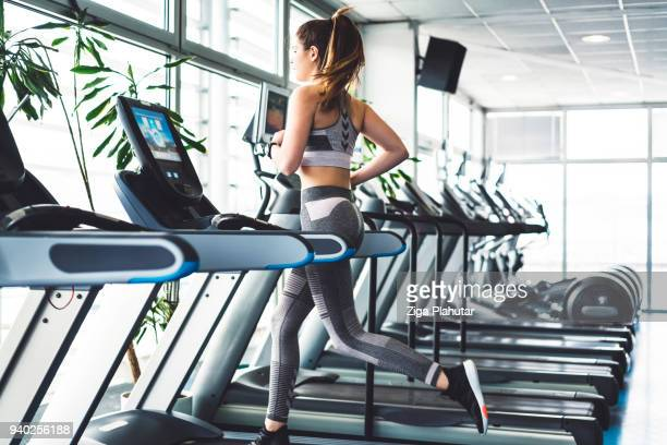 fitness woman doing a cardio session on a treadmill - gym stock pictures, royalty-free photos & images