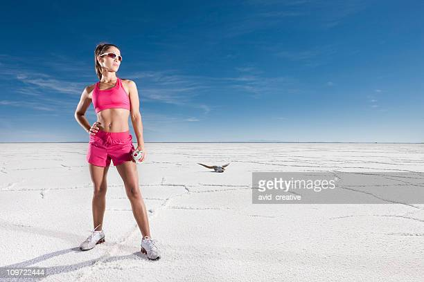 fitness woman in barren desert - bonneville salt flats stock photos and pictures