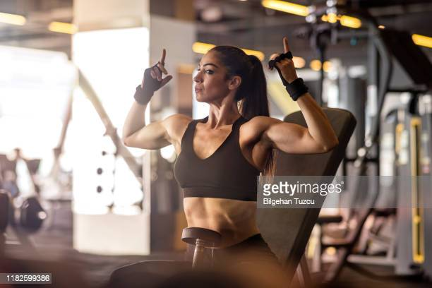 fitness woman in the gym - fanny pic stock photos and pictures