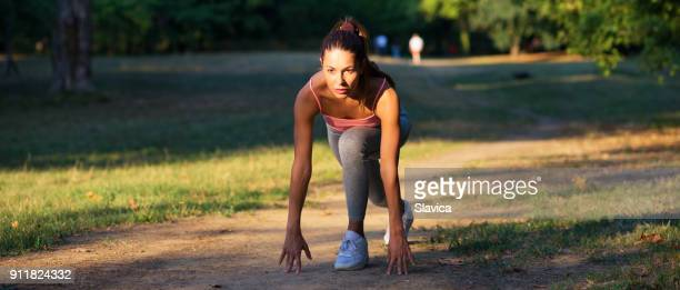 Fitness woman jogging in summer nature