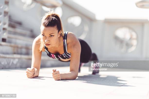fitness woman on a plank pose - plank exercise stock pictures, royalty-free photos & images