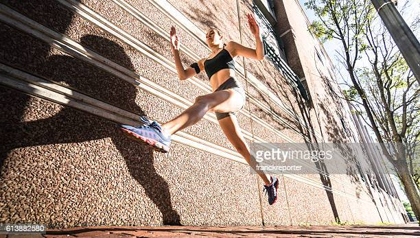 fitness woman running on the city - striding stock pictures, royalty-free photos & images
