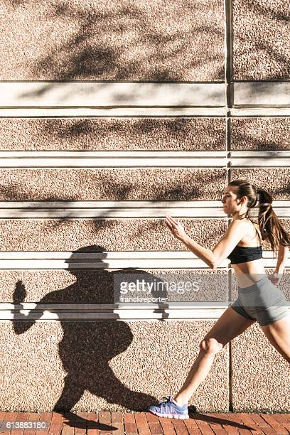 Fitness Woman running on the city