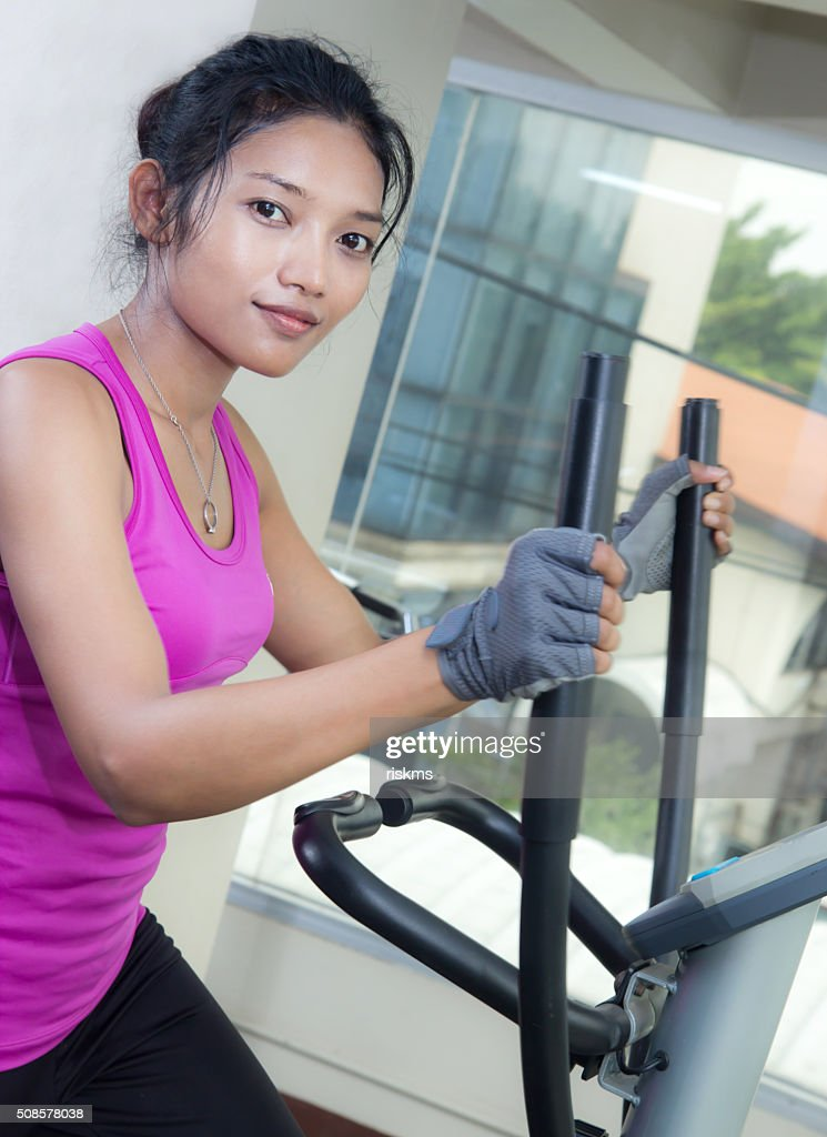 fitness woman running on treadmill : Stock Photo
