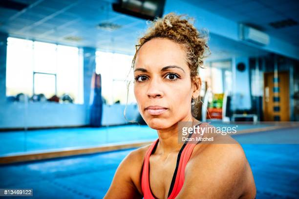 fitness woman sitting in gym - mixed boxing stock photos and pictures