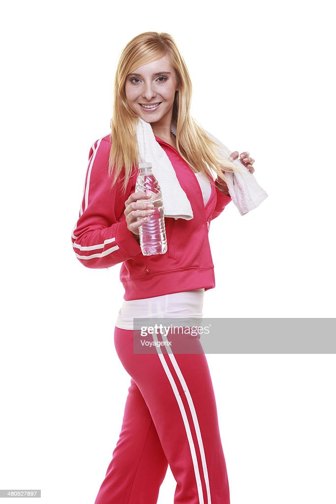 Fitness woman sport girl with towel and water bottle isolated : Stock Photo