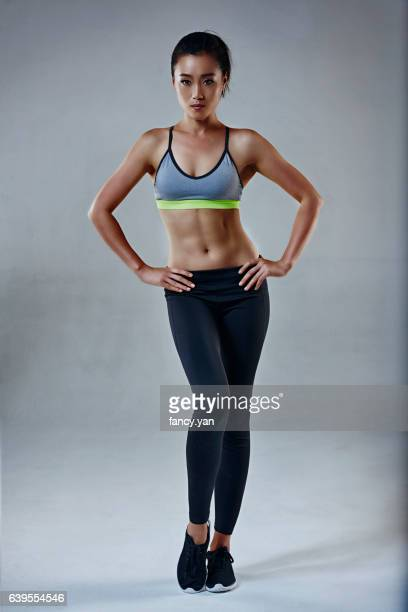 fitness woman standing - asian female bodybuilder stock photos and pictures