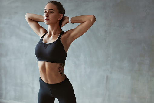 Fitness Woman Stretching Arms In Stylish Black Sport Clothes 1041835246